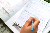 Notes being made from a workbook